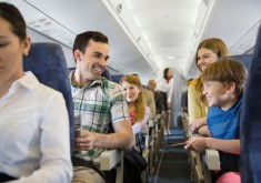 Family-traveling-in-airplane